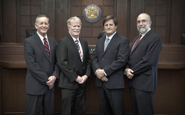 Leo Neville, Michael E. Fisher, Paul Bernier, Eric S. Goldstein of the Law department