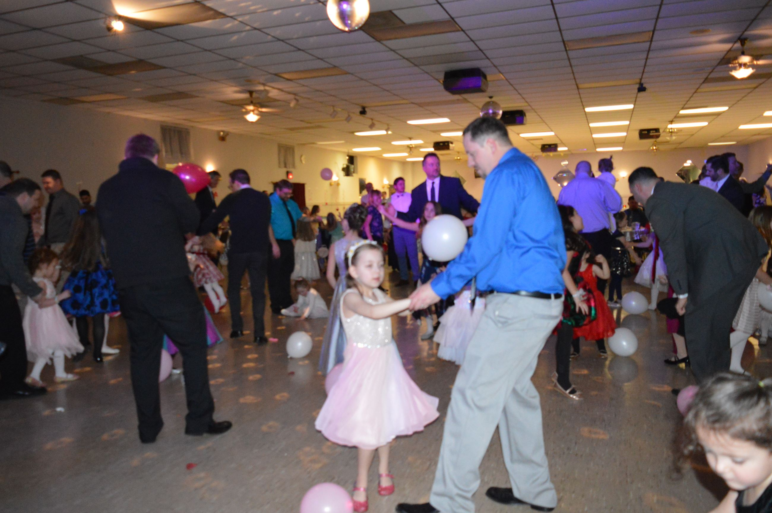 Dad and daughter dancing at Daddy Daughter Dance